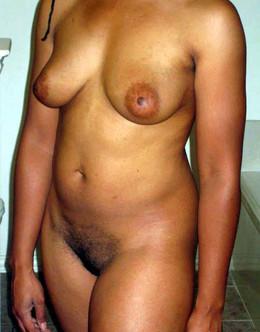Busty ebony woman with a big belly