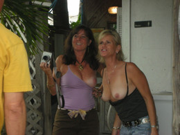 Two mature bitches flashing tits in..