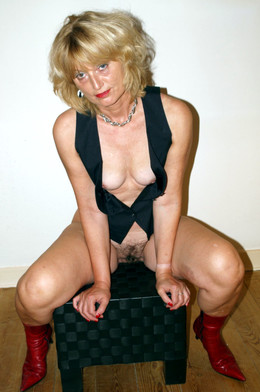 Blonde woman in red boots shows not..