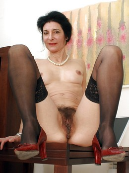 Charming, naked milf in high heels...