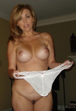 Funny busty milf shows large white..