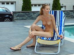 Busty girlfriend posing topless outdoor