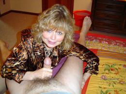 Cute blonde milf having fun by a dick..