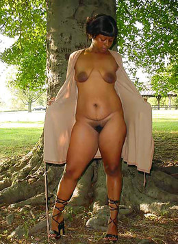Thick black mammy shines his nakedness..