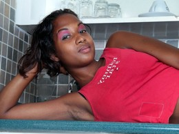 Wild African hooker posing on the bed...