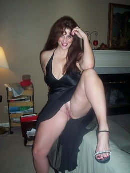 Sexpot brunette in a black dress..
