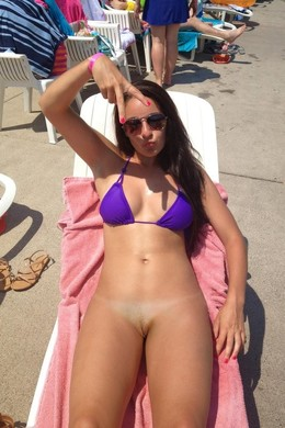 Young coed on the beach, ahaved pussy
