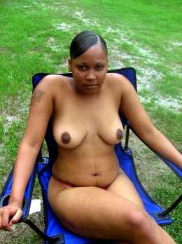 Naked ebony girlfriend squeezing her..