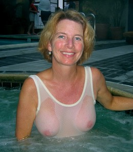 Mature blonde in wet transparent..