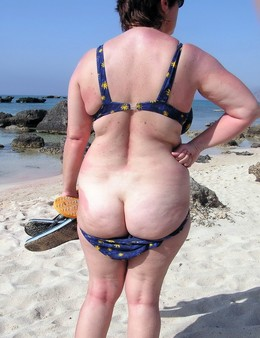 Naked old nudist at the beach. This..