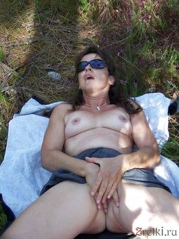 Still sexy mature woman sunbathing naked