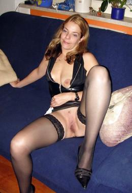 Blonde MILF with huge boobs posing..