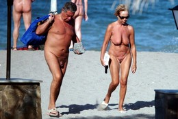 Mature couples rest on the beach fully..