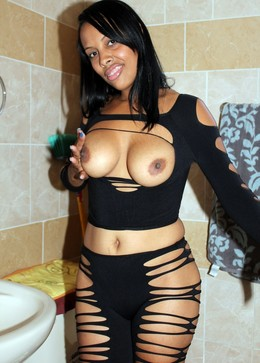 Busty ebony cutie in very sexy black..