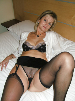 Excited mom in black lace negligee
